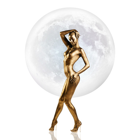 Golden woman standing in front of the full moon.