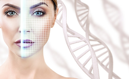 Technological scanning of face of young woman among DNA stems. Foto de archivo