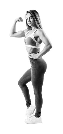 Young woman in sportswear demonstrated her beautiful muscular athletic body. 免版税图像