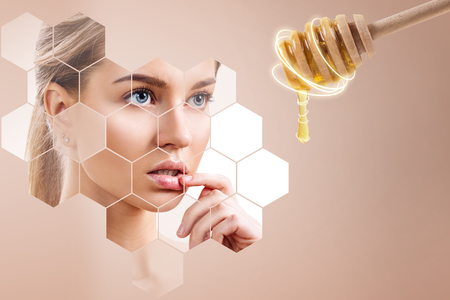 Young woman and honey spoon prepare for facial mask.