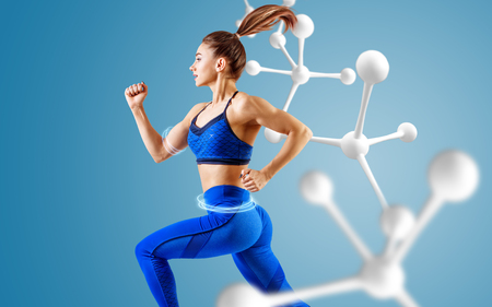 Sporty young woman runing and jumping near molecules.