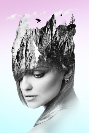 Double exposure of young woman combined with snowy mountain. Imagens