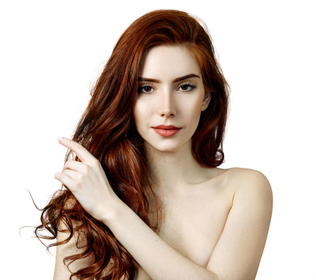 Beauty portrait of redhead woman with perfect skin. Imagens