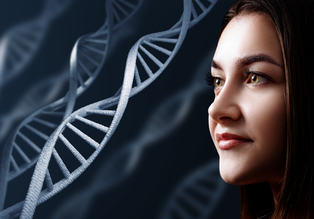 Portrait of sensual young woman among DNA chains.
