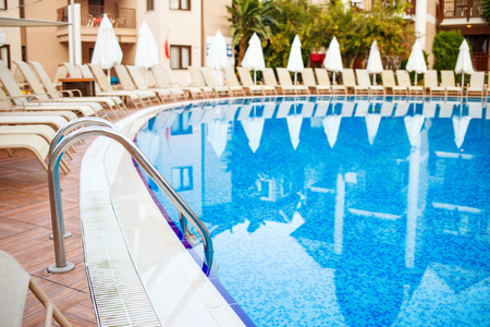 Swimming pool and lounges near hotel.