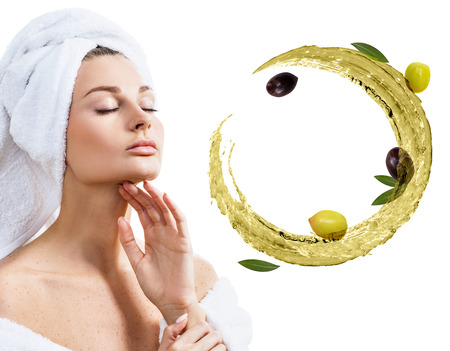 Young woman near circulate splash of olive oil. Reklamní fotografie