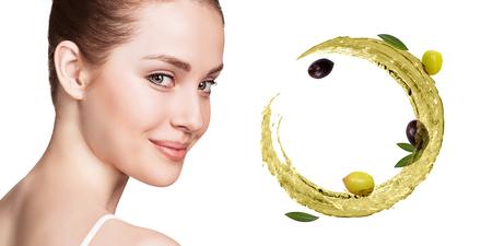 Young beautiful woman near circulate splash of olive oil. Reklamní fotografie