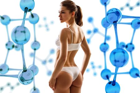 Woman with perfect body among glass molecule structure.