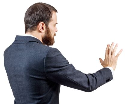 Businessman in suit shows outstretched hand withspread fingers. Stock Photo