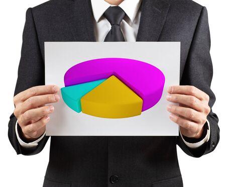 Businessman holds printout with colorful pie graph. Standard-Bild