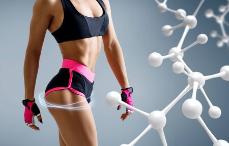 Athletic woman standing near white molecule chain. Imagens