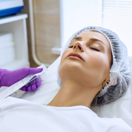 Beautiful woman on rejuvenation procedure in beauty clinic.