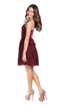 Cute elegant woman in red dress turns around. Imagens