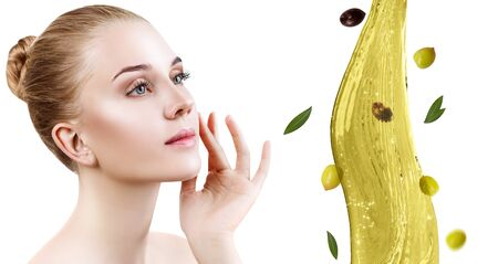 Young beautiful woman near splash of olive oil.