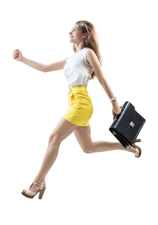 Young cheerful woman running fast with briefcase.