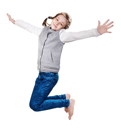 Cute smiling little girl jumping up. Banque d'images