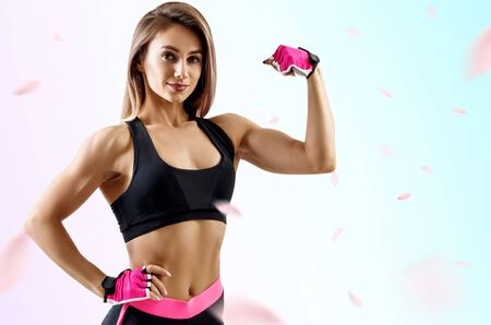 Young woman demonstrated her muscular athletic body.