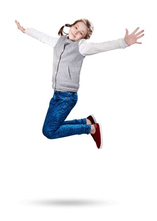 Cute smiling little girl jumping up. Imagens