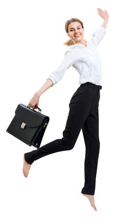 Happy business woman in formal wear jumping with briefcase. Standard-Bild - 129089180