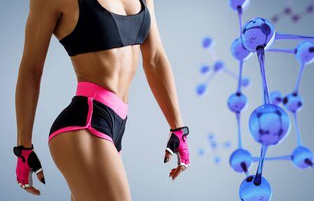 Athletic woman standing near blue glass molecule chain.