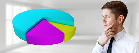 Thoughtful businessman looks on colorful pie graph in the air. Imagens