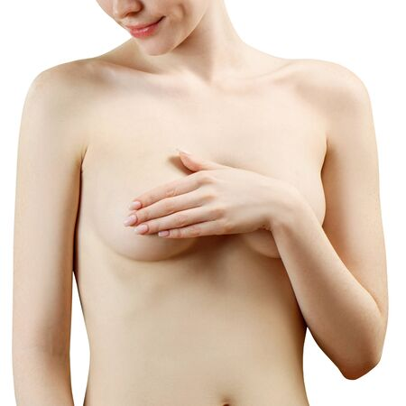 Sensual naked woman covering her breast against white background.
