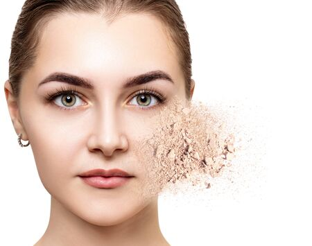 Woman face made from crumbly powder.