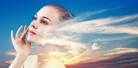 Double exposure portrait of young woman face and beautiful sunset.