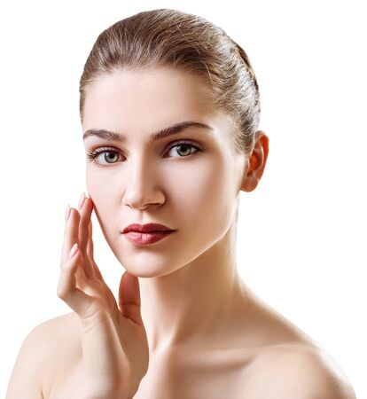 Beautiful young woman with clean healthy skin. Over white background Stock Photo