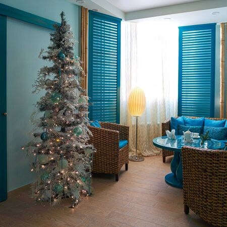 Christmas tree with blue and white toys and artificial snow. Stock Photo