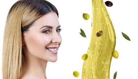 Beautiful woman near splash of olive oil. Skincare concept.
