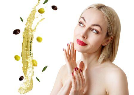 Beautiful woman near splash of olive oil. Skincare adult concept.