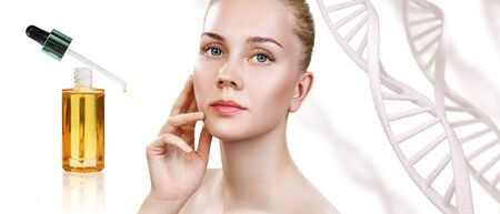 Cosmetic primer oil applying on woman face over dna background.
