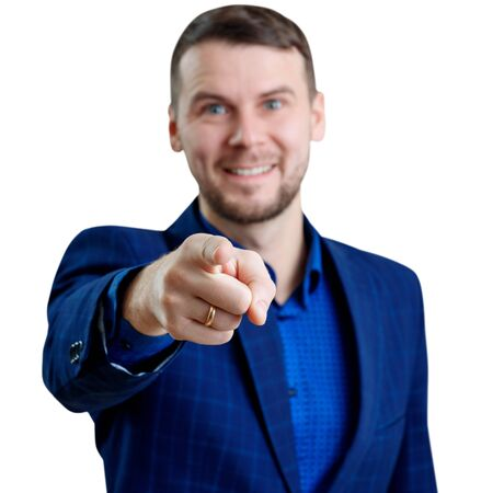 Young smiling businessman pointing to the camera.