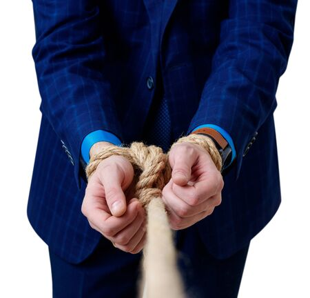 Close-up view on tied hands of businessman in blue suit.