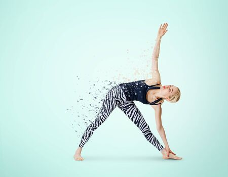 Woman in yoga posture decay on particles. Dispersion effect.