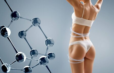 Woman with perfect body near glass molecule chain.