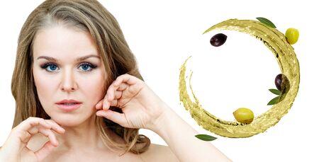 Beautiful woman near circulate olive oil. Skincare concept.