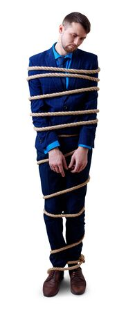 Upset businessman tied up with rope feels humility.