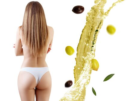 Back view on female body near olive oil splash.