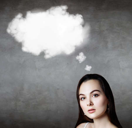 Brunette business woman with empty cloud over head.