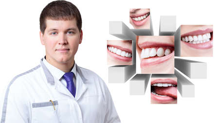 Young dentist doctor near collage of healthy beautiful smiles. Reklamní fotografie