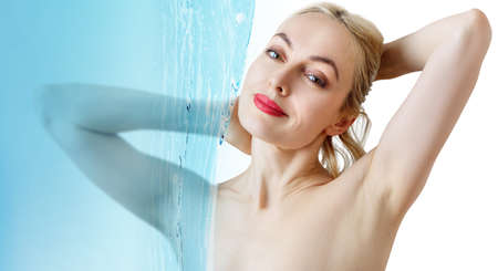 Sensual woman under water splash over white background. Reklamní fotografie