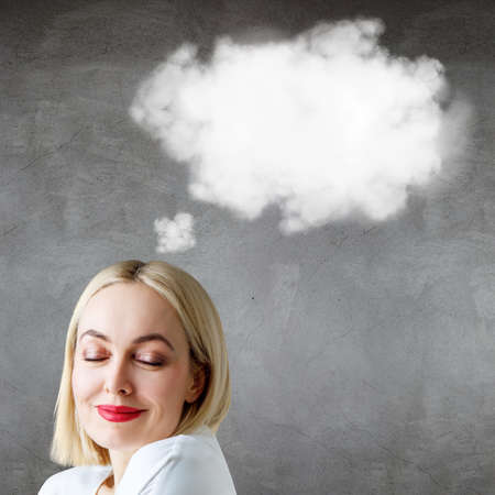 Blonde business woman with empty cloud over head.