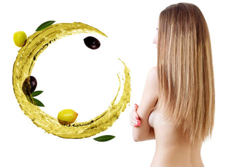 Hair treatment by oil therapy. Flying green circulate olive oil. Reklamní fotografie