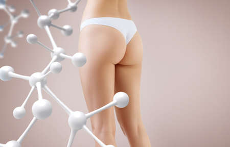 Woman with perfect buttocks near big molecule chain.