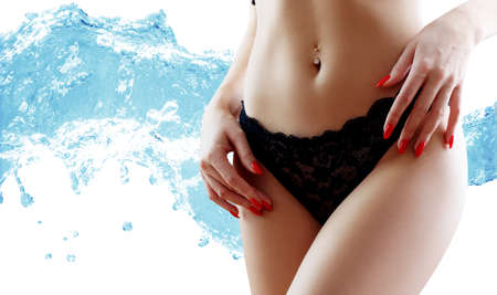 Beautiful female body over water splash background