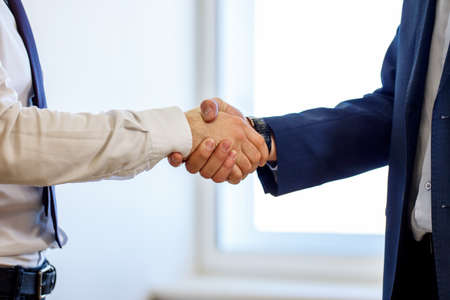 Handshake of two businessmen, close-up photo. Reklamní fotografie