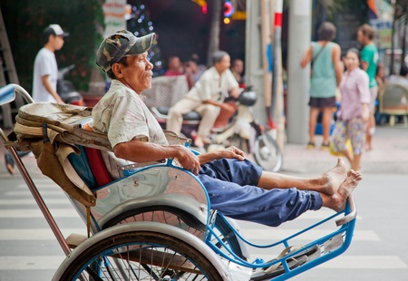 Resting cyclo driver in Vietnam