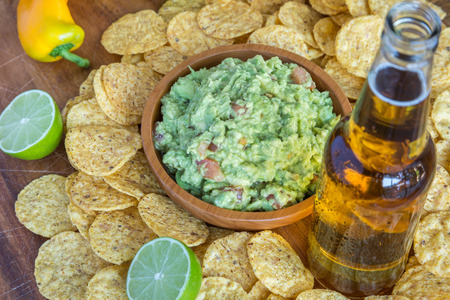 Chips guacamole dip and beer photo
